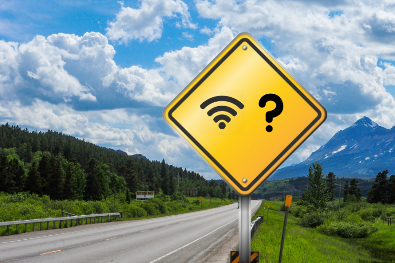 Wireless sign with a question mark on rural road