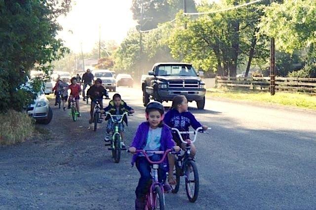 Kids ride bikes on shoulder of Hwy 162