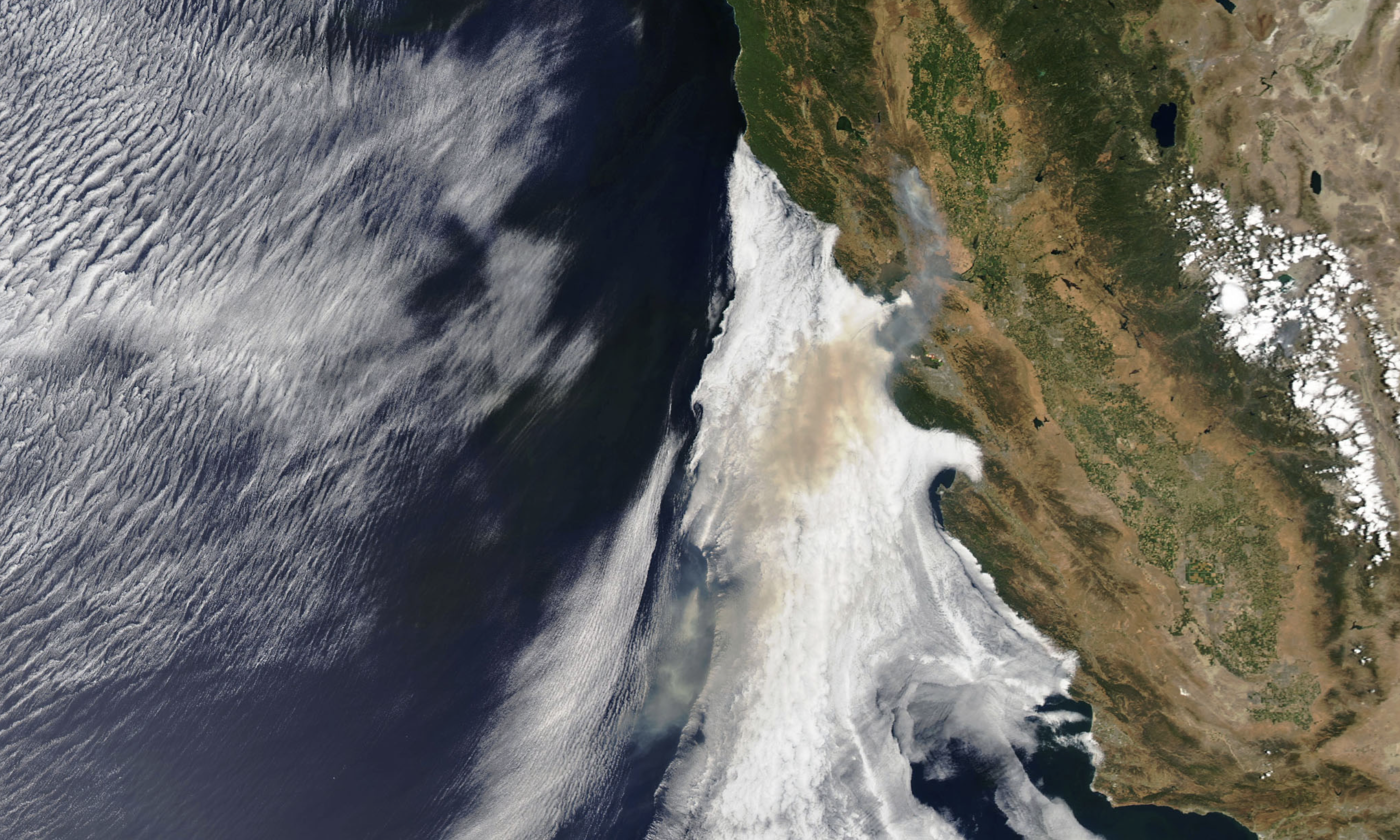 Satellite photo of California with fire smoke